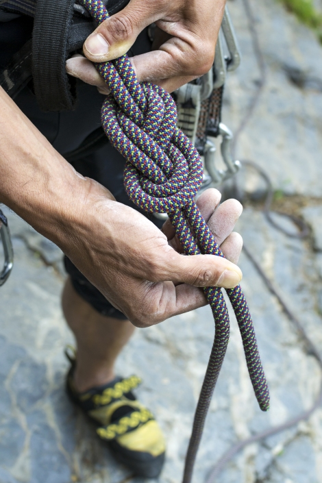A man holding a figure eight knot