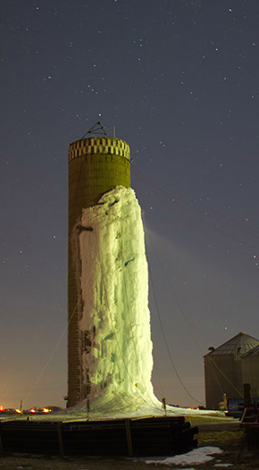 A picture of a brick water tower where the outside wall had been turned into an ice climbing wall